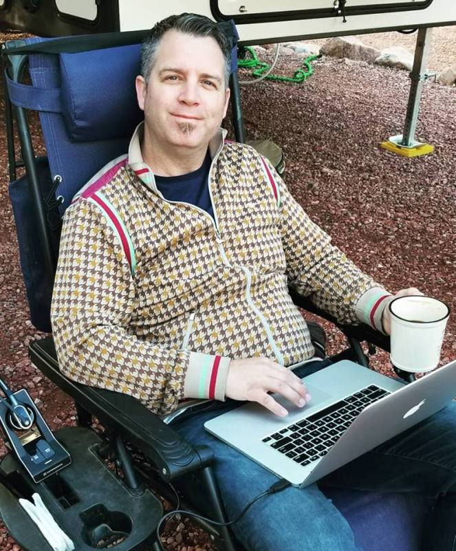 image of Seth with coffee and laptop