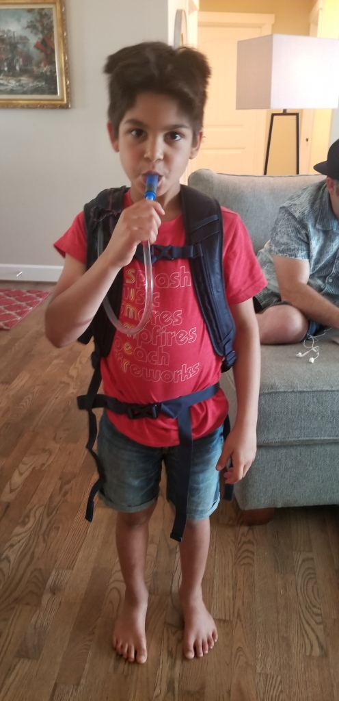 boy with backpack on